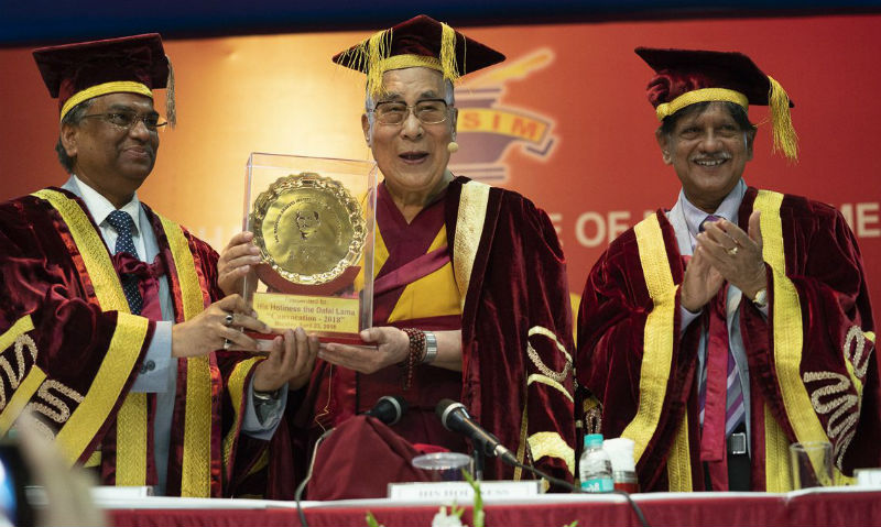 Members of the faculty taking a group photo with His Holiness the Dalai Lama at the conclusion of the Lal Bahadur Shastri Institute of Management Convocation in Delhi, India on April 23, 2018. Photo by Tenzin Choejor